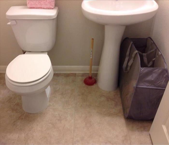 Half Bath Water Damage in Lakeway, Texas Before