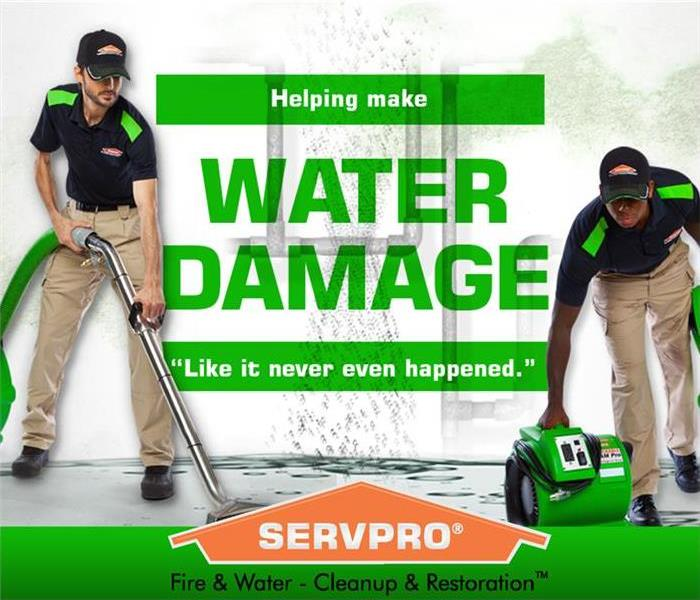"Two employees using equipment to dry water damage, ""water damage"" in middle of picture, servpro house logo in bottom center"